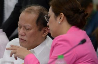 Former Philippine president Benigno Aquino (L) listens to former Philippine health secretary Janette Garin (R) during a hearing on the dengvaxia vaccine controversy, in the lower house in Manila on February 26, 2018. Former Philippine president Benigno Aquino on February 26 accused Philippine officials of politicising a raging debate on an anti-dengue vaccine that he warned could hurt the health of the public. / AFP PHOTO / TED ALJIBE