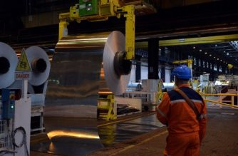 (FILES) In this file photo taken on December 12, 2014 an employee checks an aluminium roll at the Constellium factory in Biesheim, eastern France.  Major steel and aluminium producing nations condemned on March 2, 2018 US President Donald Trump's plan to impose tariffs on the industry, as stock markets plunged on fears of an imminent tit-for-tat trade war. / AFP PHOTO / Patrick HERTZOG
