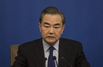 China's Foreign Minister Wang Yi attends a press conference during the First Session of the 13th National People's Congress (NPC) in Beijing on March 8, 2018. / AFP PHOTO / FRED DUFOUR