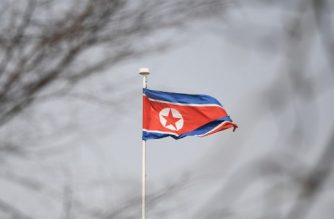 The North Korean flag flies above the North Korean embassy in Beijing on March 9, 2018. US President Donald Trump agreed to a historic first meeting with North Korean leader Kim Jong Un in a stunning development in America's high-stakes nuclear standoff with North Korea. / AFP PHOTO / GREG BAKER