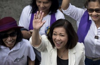 "(File photo) Philippine's Chief Justice Maria Lourdes Sereno waves as she arrives for a press conference in Manila on March 12, 2018. The Philippine Supreme Court chief justice vowed to fight ""bullying"" and save judicial independence as President Rodrigo Duterte's congressional allies launched an impeachment process March 8 to remove her from office. / AFP PHOTO / NOEL CELIS"