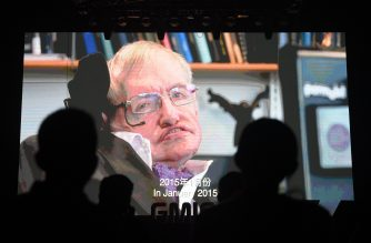 In this file photo taken on April 27, 2017 shows participants listening to a recorded speech by British physicist Stephen Hawking on artificial intelligence as his image is seen on a screen at the Global Mobile Internet Conference (GMIC) in Beijing. British scientist Stephen Hawking has died at age 76, a family announced March 14, 2018.  / AFP PHOTO / Greg Baker