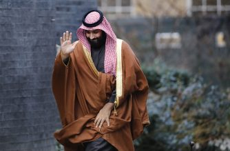 "(FILES) In this file photo taken on March 7, 2018 Saudi Arabia's Crown Prince Mohammed bin Salman waving as he arrives for talks at 10 Downing Street, in central London. Likening Iran's leader to Adolf Hitler, Saudi Arabia's crown prince warned in a US television interview that if Tehran gets a nuclear weapon, his country will follow suit. ""Saudi Arabia does not want to acquire any nuclear bomb, but without a doubt, if Iran developed a nuclear bomb, we will follow suit as soon as possible,"" Saudi Crown Prince Mohammed bin Salman said in an excerpt of the interview that aired March 15, 2018 on ""CBS This Morning.""The 32-year-old Prince Mohammed said he has referred to Iran's supreme leader Ayatollah Ali Khamenei as ""the new Hitler"" because ""he wants to expand.""  / AFP PHOTO / Tolga AKMEN"