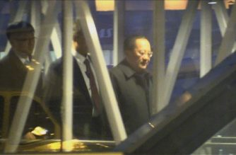 A video grab taken from an AFPTV video shows North Korean Foreign Minister Ri Yong-Ho (R) and his delegation arrive at the airport in Stockholm, Sweden, on March 15, 2018. North Korea's top diplomat arrived in Sweden for two days of talks which could play a role in setting up a proposed summit between Donald Trump and Kim Jong Un. / AFP PHOTO / AFP PHOTO AND AFPTV / Camille BAS-WOHLERT