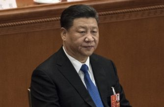 China's President Xi Jinping attends the sixth plenary session of the National People's Congress (NPC) at the Great Hall of the People in Beijing on March 18, 2018. China's rubber-stamp parliament unanimously handed President Xi Jinping a second term on March 17 and elevated his right-hand man Wang Qishan to the vice presidency, giving him a strong ally to consolidate power and handle US trade threats. / AFP PHOTO / FRED DUFOUR