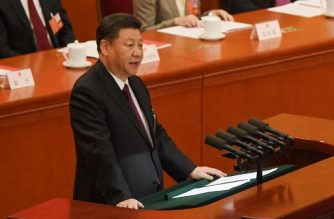 Chinese President Xi Jinping delivers a speech during the closing session of the National People's Congress at the Great Hall of the People in Beijing on March 20, 2018. / AFP PHOTO / GREG BAKER