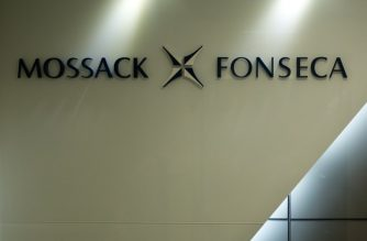 FILE PHOTO: The logo of Panama law firm Mossack Fonseca is seen at the entrance of its Hong Kong office on April 14, 2016. The so-called Panama Papers, released by the International Consortium of Investigative Journalists this month, have exposed a key role played by Hong Kong and Singapore in funnelling wealth into tax havens. Mossack Fonseca's Hong Kong offices were their busiest in the world, the ICIJ analysis showed, setting up thousands of shell companies including some linked to China's top political brass, the city's richest man, Li Ka-shing, and movie star Jackie Chan. / AFP PHOTO / AARON TAM / TO GO WITH AFP STORY BY Caroline HENSHAW
