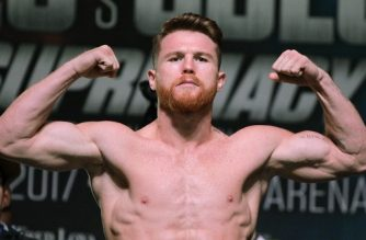 Boxer Canelo Alvarez poses on the scales during a weigh-in with Gennady Golovkin at the MGM Grand Hotel & Casino on September 15, 2017 in Las Vegas, Nevada.  Alvarez will challenge WBC, WBA and IBF middleweight champion Gennady Golovkin for his titles at T-Mobile Arena on September 16th in Las Vegas. / AFP PHOTO / John GURZINSKI