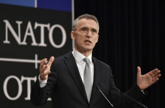 NATO Secretary-General Jens Stoltenberg gestures as he delivers a speech during the second day of Defence Ministers Council meeting at the NATO headquarters in Brussels on February 15, 2018. / AFP PHOTO / JOHN THYS