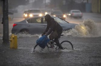 SUN VALLEY, CA - FEBRUARY 17: A bicyclist rides along a flooded street as a powerful storm moves across Southern California on February 17, 2017 in Sun Valley, California. After years of severe drought, heavy winter rains have come to the state, and with them, the issuance of flash flood watches in Santa Barbara, Ventura and Los Angeles counties, and the evacuation of hundreds of residents from Duarte, California for fear of flash flooding from areas denuded by a wildfire last year.   David McNew/Getty Images/AFP