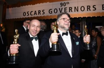 HOLLYWOOD, CA - MARCH 04: Filmmaker Guillermo del Toro (R), winner of the Best Director and Best Picture awards for 'The Shape of Water,' and producer J. Miles Dale, winner of the Best Picture award for 'The Shape of Water' attend the 90th Annual Academy Awards Governors Ball at Hollywood & Highland Center on March 4, 2018 in Hol ywood, California.   Kevork Djansezian/Getty Images/AFP