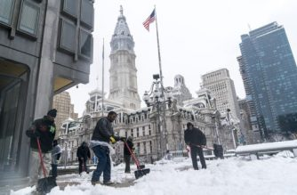 PHILADELPHIA, PA - MARCH 07: Municipal workers shovel snow on March 7, 2018 in Philadelphia, Pennsylvania, This is the second nor'easter to hit the Northeast within a week and is expected to bring heavy snowfall and winds, raising fears of another round of electrical outages.   Jessica Kourkounis/Getty Images/AFP