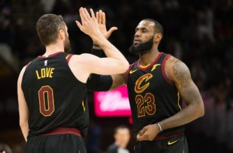 CLEVELAND, OH - MARCH 19: Kevin Love #0 celebrates with LeBron James #23 of the Cleveland Cavaliers after Love scored during the first half against the Milwaukee Bucks half at Quicken Loans Arena on March 19, 2018 in Cleveland, Ohio. NOTE TO USER: User expressly acknowledges and agrees that, by downloading and or using this photograph, User is consenting to the terms and conditions of the Getty Images License Agreement.   Jason Miller/Getty Images/AFP