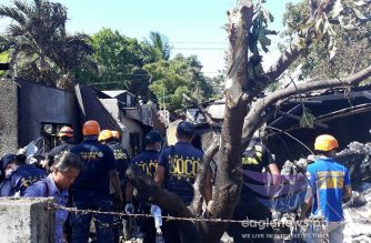 Philippine National Police Scene of the Crime Operatives (SOCO) at the scene of the plane crash in Plaridel, Bulacan where 10 people were killed including the plane's five passengers and the five members of a family who were taking their lunch at the time their house was hit by the light plane on Saturday, March 17, 2018.  (photo by Bryan Santiago, Eagle News Service)