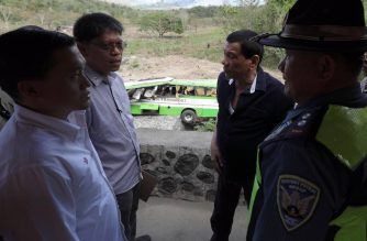 In this picture shared by Special Assistant to the President Bong Go, President Rodrigo Duterte is seen visiting the site where a Dimple Star Transport bus fell off a cliff, killing 19 people and injuring others, on Tuesday, March 20, 2018.  He was assisted by a member of the Philippine National Police-Highway Patrol Group, Land Transportation Franchising and Regulatory Board Martin Delgra, and Go. /Bong Go/