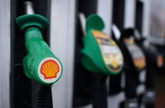 The logo of energy giant Royal Dutch Shell is pictured on pumps at a petrol station in London on January 30, 2018. / AFP PHOTO / BEN STANSALL