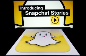 """The logo and a page of mobile app """"Snapchat"""" are displayed on tablets on January 2, 2014 in Paris. Hackers broke into Snapchat, the hugely popular mobile app, accessing the phone numbers and usernames of 4.6 million users and publishing them online, tech news website TechCrunch has announced.     AFP PHOTO / LIONEL BONAVENTURE / AFP PHOTO / LIONEL BONAVENTURE"""