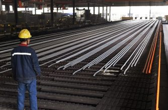 (FILES) In this file photo taken on March 10, 2018, a worker stands in a steel workshop in Zouping, in China's eastern Shandong province on March 10, 2018. President Donald Trump on Thursday authorized tariffs on as much as $60 billion of Chinese imports. / AFP photo