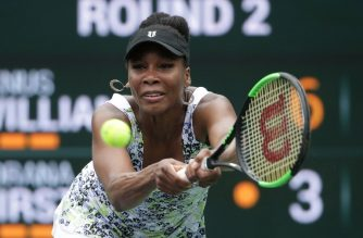 Venus Williams returns a backhand to Sorana Cirstea of Romania during the BNP Paribas Open on March 10, 2018 at the Indian Wells Tennis Garden in Indian Wells, California.   Jeff Gross/Getty Images/AFP