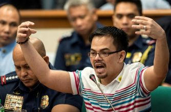 (FILE) Kerwin Espinosa (R), son of the late mayor Rolando Espinosa, gestures as he answers the Senators' question during the Senate drug hearing at the Senate building in Manila on November 23, 2016.  / AFP PHOTO / Noel Celis