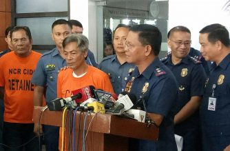 Criminal Investigation and Detection group director Roel Obusan presents Henry Halaghay and Jose Matias before the media on Wednesday, March 14, 2018. /Mar Gabriel/Eagle News Service/