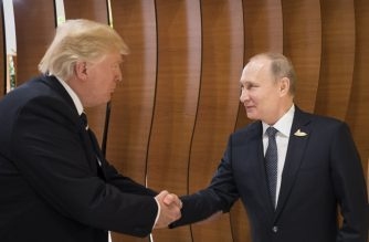 (FILE) This handout photo taken on July 7, 2017 released by the German government shows US President Donald Trump (L) shaking hands with his Russian counterpart Vladimir Putin during a G20 summit in Hamburg, northern Germany, on July 7, 2017. / AFP photo / Bundesregierung / Steffen Kugler