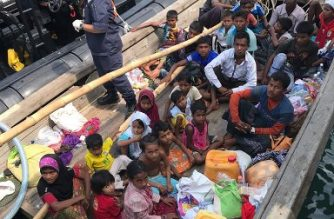 "This undated handout photo released by the Malaysian Maritime Enforcement Agency on April 3, 2018 shows members of the Malaysian Maritime Enforcement Agency detaining a boat carrying Rohingya refugees in Malaysian territorial waters off the island of Langkawi. The boat carrying dozens of Rohingya from Myanmar arrived in Malaysia on April 3 and the refugees will be allowed to enter the country, but an expert downplayed fears it might herald a new mass exodus. / AFP PHOTO / MALAYSIAN MARITIME ENFORCEMENT AGENCY / handout / -----EDITORS NOTE --- RESTRICTED TO EDITORIAL USE - MANDATORY CREDIT ""AFP PHOTO / Malaysian Maritime Enforcement Agency"" - NO MARKETING - NO ADVERTISING CAMPAIGNS - DISTRIBUTED AS A SERVICE TO CLIENTS"