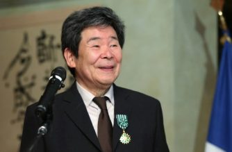 """(FILES) This file picture taken on April 7, 2015 shows Japanese animation movie director Isao Takahata smiling as he received the """"Officier of L'Ordre des Arts et des Letters"""" from the French ambassador to Japan at the French embassy in Tokyo. Oscar-nominated Japanese anime director Isao Takahata, who co-founded the Studio Ghibli and was best known for his work """"Grave of the Fireflies"""", has died aged 82, the studio said on April 6, 2018. / AFP PHOTO / JIJI PRESS / JIJI PRESS /  - Japan OUT"""