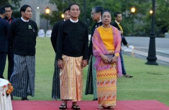 (File photo)  This picture taken on April 6, 2018, shows new Myanmar President Win Myint (C) and First Lady Cho Cho arriving for a reception following the swearing-in ceremony of the new government in Naypyitaw.  / AFP PHOTO / Thet Aung
