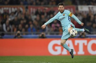 FC Barcelona's Argentinian forward Lionel Messi kicks the ball  during the UEFA Champions League quarter-final second leg football match between AS Roma and FC Barcelona at the Olympic Stadium in Rome on April 10, 2018. / AFP PHOTO / LLUIS GENE