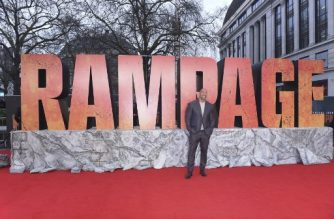 "(FILES) In this file photo taken on April 11, 2018, US actor Dwayne Johnson poses on the carpet for the European premiere of the film ""Rampage"" in London . Sci-fi action flick ""Rampage"" topped North American box offices over the weekend, taking in an estimated $34.5 million to barely beat out horror film ""A Quiet Place,"" industry tracker Exhibitor Relations said on April 15, 2018. / AFP PHOTO / Anthony HARVEY"