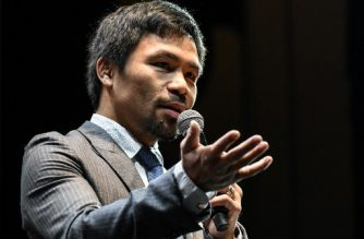 Filipino boxing idol Manny Pacquiao speaks during a press conference in Kuala Lumpur on April 20, 2018, ahead of his world welterweight boxing championship bout against Argentina's Lucas Matthysse in July.  / AFP PHOTO / Mohd RASFAN