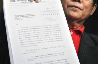 Lawyer Oliver Lozano shows a copy of a fresh impeachment complaint he filed against President Gloria Arroyo at the Philippine Congress in Manila, 16 January 2006. President Arroyo last year survived an opposition-led impeacment complaint over charges she cheated in the May 2004 polls. Lozano was among those who filed a complaint last year, but his filing now could violate a one-year ban on successive filing of impeachment cases.   AFP PHOTO  / AFP PHOTO / STR