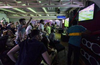 FILE PHOTO: Venezuela fans react while watching on TV the U-20 World Cup final football match between Venezuela and England on June 11, 2017, in Caracas, Venezuela. / AFP PHOTO / LUIS ROBAYO