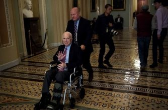 "Senator John McCain (R-AZ) uses a wheelchair on Capitol Hill December 1, 2017 in Washington, DC. Donald Trump's tax reform plan has overcome pockets of resistance within Republican ranks, US senators said Friday, setting up a vote that could provide the president with his first major legislative victory.""We have the votes,"" Senate Majority Leader Mitch McConnell told reporters as he entered the chamber.  / AFP PHOTO / Brendan Smialowski"
