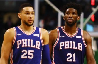 BOSTON, MA - JANUARY 18: Ben Simmons #25 and Joel Embiid #21 of the Philadelphia 76ers walk off the court during a time out in the second half against the Boston Celtics at TD Garden on January 18, 2018 in Boston, Massachusetts.   Tim Bradbury/Getty Images/AFP