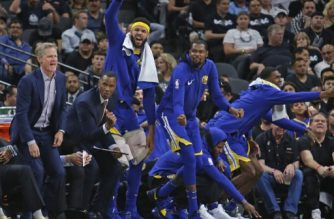SAN ANTONIO,TX - APRIL 19: Steve Kerr head coach of the Golden State Warriors and the rest of the warriors celebrate a basket against the San Antonio Spurs at AT&T Center on April 19 , 2018 in San Antonio, Texas. NOTE TO USER: User expressly acknowledges and agrees that , by downloading and or using this photograph, User is consenting to the terms and conditions of the Getty Images License Agreement.   Ronald Cortes/Getty Images/AFP