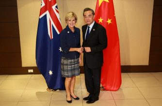 (FILE) China's Foreign Minister Wang Yi (R) shakes hands with Australian Foreign Minister Julie Bishop during their bilateral meeting on the sidelines of the 50th Association of Southeast Asian Nations (ASEAN) regional security forum in suburban Manila on August 6, 2017. / AFP PHOTO / POOL