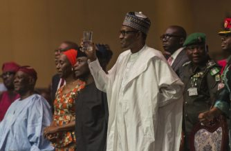 Nigerian president Muhammadu Buhari (C) proposes a toast in Lagos, on March 29, 2018, as he attends the rally organized to celebrate the 66th birthday of the leader of the All Progressive Congress (APC) Asiwaju Bola Tinubu. /AFP Photo/ Stefan Heunis