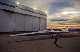 """This NASA image released April 3, 2018 shows an artist's concept of the low-boom flight demonstrator outside the Lockheed Martin Aeronautics Company's Skunk Works hangar in Palmdale, California. NASA has inked a deal with Lockheed Martin to develop a supersonic """"X-plane"""" that could break the sound barrier without a sonic boom, officials said April 3, 2018. The $247.5 million contract allows for the design, building and testing of a plane that would make its first test flight in 2021, NASA said.The experimental plane """"will cruise at 55,000 feet (16,764 meters) at a speed of about 940 mph (1,513 kph) and create a sound about as loud as a car door closing, 75 Perceived Level decibel (PLdB), instead of a sonic boom,"""" the US space agency said in a statement.  / AFP PHOTO / NASA / Handout / RESTRICTED TO EDITORIAL USE - MANDATORY CREDIT """"AFP PHOTO /NASA/LOCKHEED MARTIN/HANDOUT"""" - NO MARKETING NO ADVERTISING CAMPAIGNS - DISTRIBUTED AS A SERVICE TO CLIENTS"""