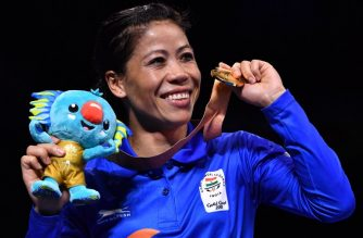 India's Mary Kom poses with her gold medal after beating Northern Ireland's Kristina O'Hara in their women's 45-48kg final boxing match during the 2018 Gold Coast Commonwealth Games at the Oxenford Studios venue on the Gold Coast on April 14, 2018. / AFP Photo/ Anthony Wallace