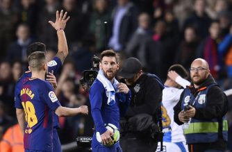 Barcelona's Argentinian forward Lionel Messi (C) walks off with the match ball after scoring a hat-trick at the end of the Spanish league football match between FC Barcelona and Club Deportivo Leganes SAD at the Camp Nou stadium in Barcelona on April 7, 2018. / AFP Photo / Josep Lago