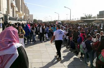 A handout photo released on February 20, 2018 by the Kuwaiti newspaper, Kuwait Times, shows Filipino workers trying to get amnesty waiting outside the Philippine embassy in Kuwait City.    / AFP photo / Kuwait Times