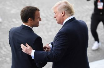 (FILES) In this file photo taken on July 14, 2017 French President Emmanuel Macron (L) bids farewell to his US counterpart Donald Trump after the annual Bastille Day military parade on the Champs-Elysees avenue in Paris. Macron on April 22, 2018, reiterated demands that Europe be definitively spared from punishing new US steel and aluminum tariffs, days before a temporary exemption is due to expire.  / AFP Photo / Alain Jocard