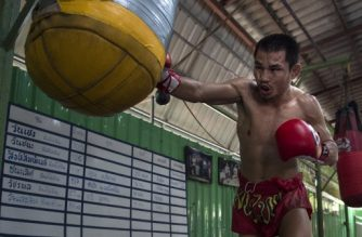 (FILES) This file photo taken on January 31, 2018 shows the current World Boxing Council (WBC) mini-flyweight champion, Wanheng Menayothin, punching a bag during a training session in Bangkok. At 5ft 2in (1.57m) and weighing just 105lb (47.6kg), minimumweight Wanheng Menayothin is shorter, leaner and significantly less wealthy than boxing great Floyd Mayweather Jr, who retired undefeated over 50 fights. If Wanheng wins his next bout on May 2, 2018 he will equal Mayweather's history-making feat of going unbeaten for 50 fights. / AFP PHOTO / LILLIAN SUWANRUMPHA / TO GO WITH THA-boxing-sport-Mayweather by Joe FREEMAN
