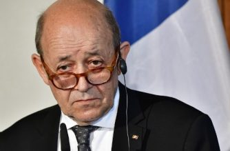 French Foreign Minister Jean-Yves Le Drian looks on during a joint press conference with his German counterpart prior a meeting to discuss the EU, common defence policy and international issues on May 7, 2018 in Berlin. / AFP PHOTO / Tobias SCHWARZ