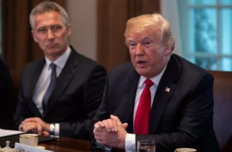 US President Donald Trump(R) meets with NATO Secretary General Jens Stoltenberg in the Cabinet Room at the White House in Washington, DC, on May 17, 2018. / AFP PHOTO / NICHOLAS KAMM