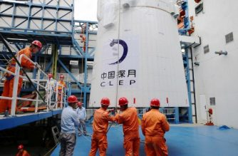 """This undated picture released on May 21, 2018 shows employees loading the Queqiao (""""Magpie Bridge"""") satellite at the Xichang launch centre in Xichang, China's southwestern Sichuan province.  China on May 21 launched a communications relay satellite that will allow a rover to send images from the far side of the Moon on an unprecedented mission later this year.  / AFP PHOTO / - / China OUT"""