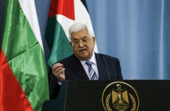 (FILES) In this file photo taken on March 22, 2018 Palestinian Authority president Mahmoud Abbas gestures while speaking during a joint press conference with the visiting Bulgarian president at the Palestinian Authority headquarters in the West Bank city of Ramallah. Palestinian president Mahmud Abbas is suffering from pneumonia but his condition is improving, officials said late on May 21, 2018.   / AFP PHOTO / ABBAS MOMANI