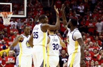 HOUSTON, TX - MAY 14: Kevin Durant #35 of the Golden State Warriors reacts with Draymond Green #23 of the Golden State Warriors in the fourth quarter against the Houston Rockets in Game One of the Western Conference Finals of the 2018 NBA Playoffs at Toyota Center on May 14, 2018 in Houston, Texas. NOTE TO USER: User expressly acknowledges and agrees that, by downloading and or using this photograph, User is consenting to the terms and conditions of the Getty Images License Agreement.   Ronald Martinez/Getty Images/AFP